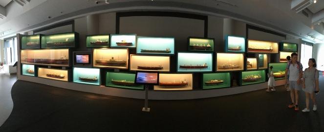 a wall full of ship models